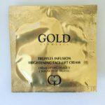 Gold coloured square containing sample black truffle face cream